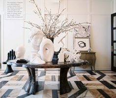 The floor is amazing. I love the table and sculptures too. This is an energizing space.