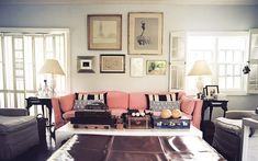 Living Room Vintage Photo - Framed art above a pink couch with black-and-white pillows