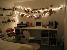 Illuminate your photos by hanging them alongside twinkle lights. | 37 Ingenious Ways To Make Your Dorm Room Feel Like Home