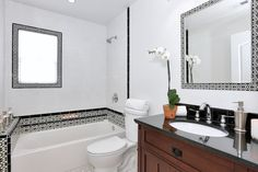 This spanish style bathroom features white subway tile trimmed with black and white talavera tile giving it it's crisp yet stunning aesthetic. Design: Marilynn Taylor, TheTayloredHome.com
