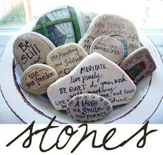 have each person write message on stone and pass to another; or have pre-written for people to pick and share with others