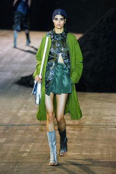 Phillip Lim showcased looks that were quirky, feminine and sporty, with shades of green, blue, white and sand.