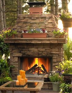 Beautiful- achieve the outdoor living with an outdoor fire place. maybe under the the patio bricks place heated cooling system to use the area in late fall early winter to very early spring. Diy Outdoor Fireplace, Backyard Fireplace, Backyard Patio, Wood Fireplace, Fireplace Ideas, Fireplace Design, Stackstone Fireplace, Backyard Landscaping, Landscaping Ideas