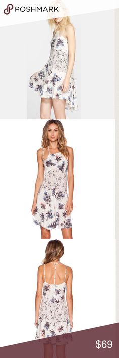 """Free People Crescent Slip Dress Size M Sold-out dress from Free People.  Crescent Slip Dress.  Lightweight floral print with delicate straps.  High/low skirt.  Length is 32"""".  100% Rayon.  Unlined, semi-sheer. Free People Dresses"""