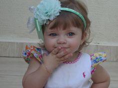 Arco verde agua,flor e lacinho verde agua,disponivel nas cores vermelho,rosa bebe e branco;  http://www.elo7.com.br/nicetiara