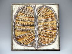 Lisa Larson ceramic leaf tile.
