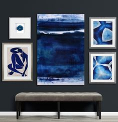 To create a gallery wall with a cohesive look, hang pieces in the same color family.