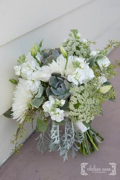 Succulent and white floral bouquet.  Queen Ann's lace, spider mums, stock, dusty miller and lisianthus.  White and green bouquet.
