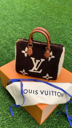 Brand new Louis Vuitton Speedy Bandouliere Monogram Teddy Fleece 25. Made of fleece and calf leather trim, polished gold-tone hardware and removable leather strap, with one interior side pocket. This Limited Edition handbag includes the original box, dust bag, lock, two keys, and removable strap. Shop Louis Vuitton new and pre-owned handbags at From Runway With Love.