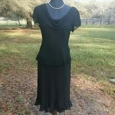 Black Beaded Top & Skirt Pretty sleeveless top has sheer material with bead embellishments on shoulder and bottom. Round cowl  type neck. Skirt has uneven lenghts, front is shorter than back. Flouncy with sequin embellishment. Very pretty outfit. Necklace not included. Sandra Darren  Skirts