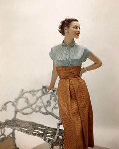 March 1949, Model is wearing a contrasting polka-dotted dress with orange skirt and blue top. Image by © Condé Nast Archive/Corbis