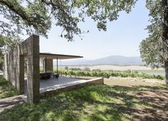 Modern pavilion for wine tasting in the Napa Valley made from wood and concrete.