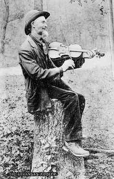 Fiddle Player - Encyclopedia of Arkansas after every tree he chops down he gets to play his fiddle...weee