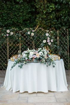 Modern wedding sweetheart table idea - sweetheart table with gold trellis and lush flower + greenery centerpiece {Lucas Rossi Photography}