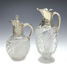 A Victorian silver mounted and cut glass claret jug, Edgar Finley and Hugh Taylor, London 1888, the ovoid glass body hobnail cut, plain scroll handle, the cover and neck mounts chased with flowers and foliage and foliate finial