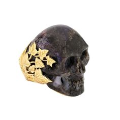 Theo Fennell 18ct gold and carved-opal Marion Skull Ring, £11,500.