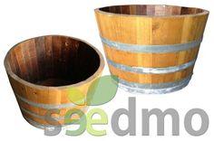 Maceta realizada a partir de barricas de roble, terminada en barniz de exteriores, ideal para su uso en jardín por su alta resistencia y gran capacidad de almacenaje. alto 45 cm, ancho 70 cm