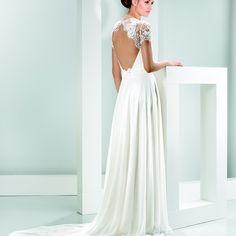 Vestido precioso, con una espalda increíble.
