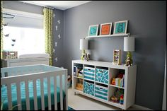 Expedit and shelf, put legs on it from Ikea, cute for a baby room