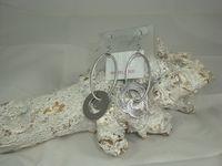 hippe zilveren oorbellen met hangende ringen