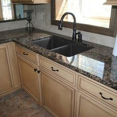 Traditional Kitchen Remodel with Duraceramic Floors and Baltic Brown Granite by Hatchett Design/Remodel