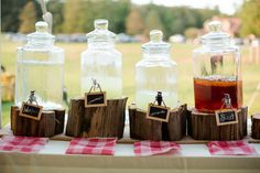 Rent glass beverage servers and hang wooden chalkboard tags for a wedding or shower