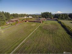 Equestrian Estate for Sale in Pierce County in Washington. Private 159 m/l Acre Estate at the former location of Tanwax Greens Golf Course. This property features 7,218 sq.ft. Residence with 3 plus bedrooms and 2- 3/4 baths. Includes the In-Ground indoor pool with Hot Tub & Sauna. Spectacular view of Mt. Rainier.