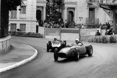 This is Phill Hill drifting his Ferrari 246 around the impossibly tight Monaco street circuit with Bruce Maclaren in hot pursuit in his Cooper T53.