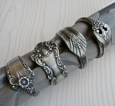Repurposed silverware napkin rings (or ACTUAL rings). Thrift store cutlery, dremel and something to heat them up a bit to bend? This should be completely DIYable. Silverware Jewelry, Spoon Jewelry, Spoon Rings, Jewlery, Women's Jewelry, Silver Spoons, Diy Schmuck, Bijoux Diy, Dremel