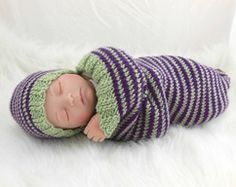 http://www.heavenboundhca.com/cocoon-sleep-sack-sleep-bag-blanket-wrap-in-purple-green-stripes $25