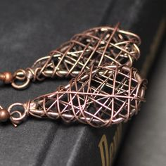 copper wire wrapped danlge earrings  CAGED  by sparklingtwi, $15.00