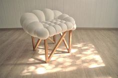 SNÖBÄR is Swedish word for snowberry. This is a play of word, shapes and materials. Its construction is made out of oak, hard and resistant wood, which contrasts soft berry seating shape.