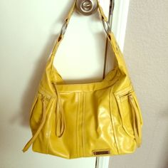 Kenneth Cole Reaction bag A brand new (without tags) bag of a gorgeous deep yellow.  Has two side pockets with zippers.            Please consider BUNDLING for the best deal!  Kenneth Cole Reaction Bags
