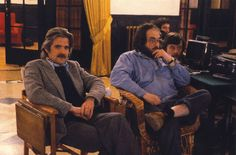 Stanley Kubrick sits on the Lobby set of The Shining with Executive Producer (and Kubrick's brother-in-law) Jan Harlan. Film Editor Ray Lovejoy sits behind Kubrick.