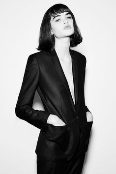 Mid length bob with bangs, bold and classic.  Love the long lines of the suit coat and sheen of material.
