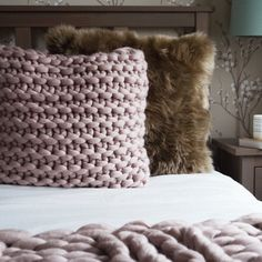 This chunky knit, large square cushion adds an authentic and tactile aesthetic to a bedroom or living room. Its soft blush mink colour is natural enough that it blends in nicely with tonal decor without overwhelming yet the textured chunky knit makes it irresistibly touchable. The colour works really well with browns, creams and pink in particular as well as dusty shades from blues to neutrals. I hand knit each cushion in my studio in devon from start to finish on chunky needles using…