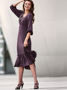This plum modest mother of the bride dress features a peasant look about it that is genuinely rich in a sense of fashion in so many ways. The flounce at the bottom of the skirt adds some unique fla…