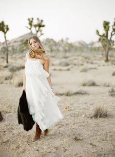 Bohemian white mid dress and chestnut booties: http://www.stylemepretty.com/2016/09/19/joshua-tree-engagement-session/ Photography: https://www.ktmerry.com/