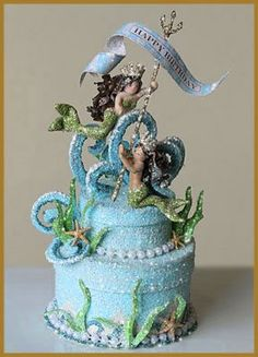 Under the Sea Party, I think the Sea themed cakes are beautiful, I'd never make them, or have a fake version in my house but they are so pretty to look at...