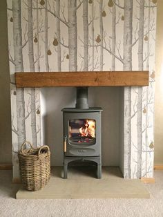 Cole & Son Wood & Pears wallpaper on chimney breast. Wood, Rustic Fireplaces, House Design, Home, Fireplace Hearth, Wallpaper Living Room, Wood Wallpaper, New Homes, Wood Burning Stove