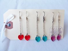 3 pairs of Swarovski crystal heart dangling earrings in blood red, blue green and deep pink by SparkleandComfort, $6.99
