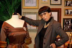 """Designer Edith Head with the dress from the  """"fasten your seat belts"""" scene from Bette's movie, """"All About Eve."""""""