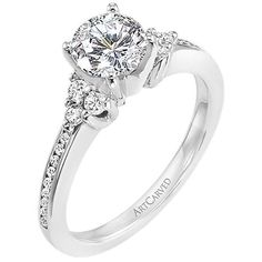 "Artcarved ""Kayla"" engagement ring features trios of diamonds on either side of the center stone, surrounded by channel-set diamonds in the band.  At Greenwich Jewelers."