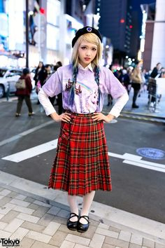Nanaho is wearing a jeweled beret over her blue ombre braids hairstyle, a unicorn top from Nadia Harajuku, a plaid skirt from Kinji Harajuku, white tights, and shoes from Meirire.