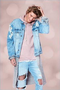 Jordan Barrett wears distressed denim for Forever 21's holiday 2016 campaign.