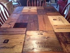 Dining room table redone with wine boxes.
