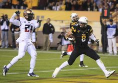 Nov. 30 - Arizona safety Tra'Mayne Bondurant (21) can't stop ASU D.J. Foster (8) from scoring a touchdown during the fourth quarter of the T...