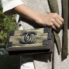 Spotted: Small, stylish cross-over bags - a key item we saw at London Fashion Week. This Chanel bag is on our wishlist.