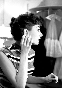 Audrey Hepburn. Love this sleeveless striped tee she's wearing.