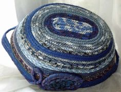 inverted view of Blue plaid and homespun oval shaped basket with handles made by Diane Fama